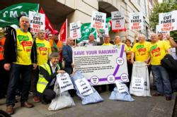 Over 50 MP's sign motion against rail cuts