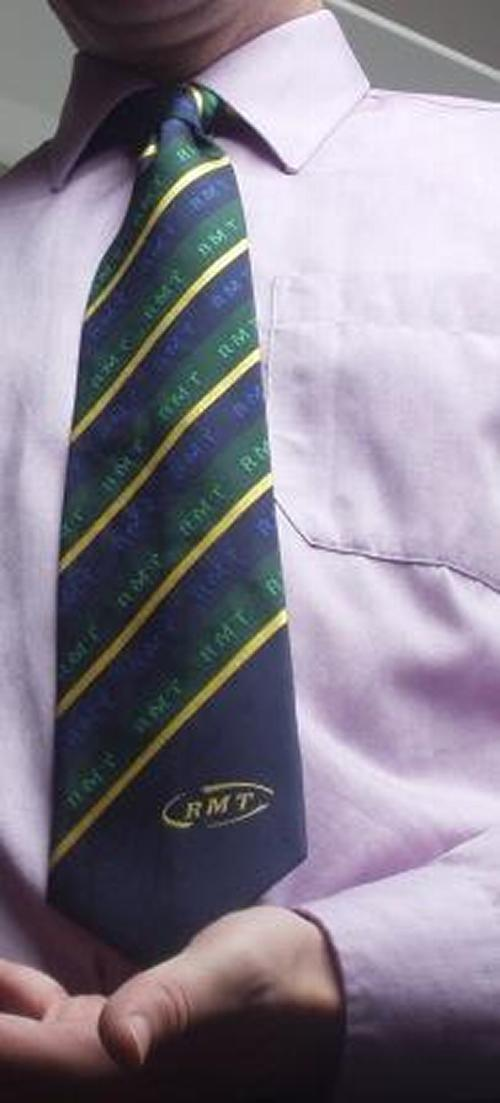 Yellow and Green Striped Tie on Blue Background