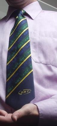 yellow-and-green-striped-tie-on-blue-background